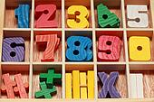 math game for junior age with colored wooden signs of numbers ...