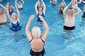 Stock Photo of Group of senior people performing water aerobics in ...